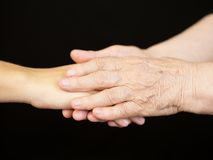 Young hand in old hand Stock Photography