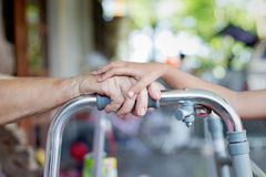 Young hand touch old woman  hand Royalty Free Stock Photo