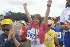 Young Handicapped athlete celebrating. During Special Olympics, UCLA, CA Royalty Free Stock Images