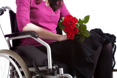Young handicapped girl with roses Royalty Free Stock Photos