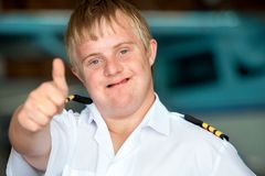 Young handicapped pilot showing thumbs up. Stock Image