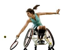 Young handicapped tennis player woman welchair sport isolated si. One caucasian young handicapped tennis player woman in welchair sport tudio in silhouette royalty free stock image