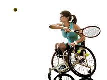 Young handicapped tennis player woman wheelchair sport isolated. One caucasian young handicapped tennis player woman in wheelchair sport tudio in silhouette stock image