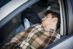 Young handosme man sleeping in his car Royalty Free Stock Photography
