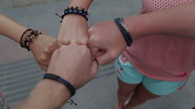 Young hands folded on one another showing friendship stock video footage