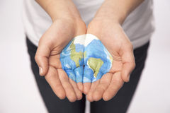 Young Hands Hold World Royalty Free Stock Image