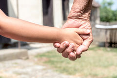 Young hands holded by old ones. Selective focus Royalty Free Stock Photo