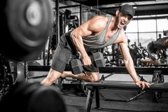 One-arm dumbbell rows in gym Royalty Free Stock Photos