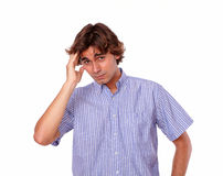 Young handsome adult man looks tired. Stock Images