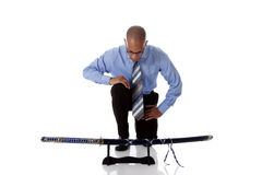 Young handsome African American businessman, sword Stock Images