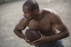 Handsome african american male football player with ball. Young handsome african american male football player with ball Stock Image