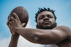 Handsome african american male football player with ball. Young handsome african american male football player with ball Royalty Free Stock Image