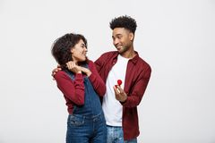 Young handsome african american man surprisingly ask her girlfriend for proposal. Young handsome african american men surprisingly ask her girlfriend for royalty free stock image