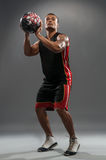 Young handsome African man playing basketball stock photography