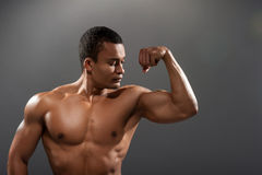Young handsome African man posing shirtless Royalty Free Stock Photo