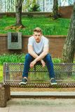Young handsome American Man relaxing at street park in New York Royalty Free Stock Photography