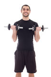 Young handsome arabic man in sportswear doing exercises with dum Stock Photos