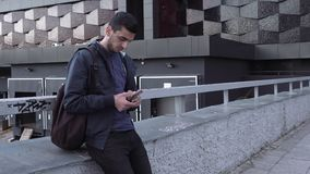 Young handsome arabic man using smartphone in city. Young handsome arabic man using a smartphone in the city stock video