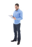 Young handsome arabic man writing something on clipboard isolate. D on white background Stock Photography
