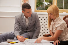 Young handsome architect discussing ground plan Royalty Free Stock Photo
