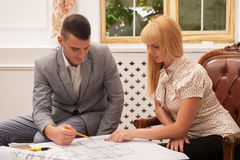 Young handsome architect discussing ground plan Stock Photography