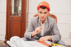 Young handsome architect engineer working on Royalty Free Stock Image
