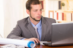 Young handsome architect working in an office Royalty Free Stock Photo