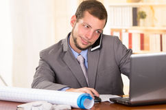 Young handsome architect working in an office Stock Photography