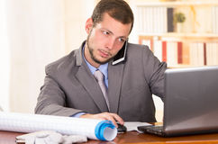 Young handsome architect working in an office Royalty Free Stock Images