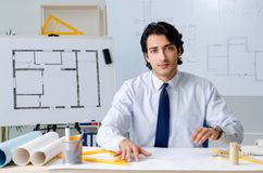 The young handsome architect working on the project. Young handsome architect working on the project stock photos