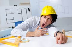 The young handsome architect working on the project. Young handsome architect working on the project royalty free stock image