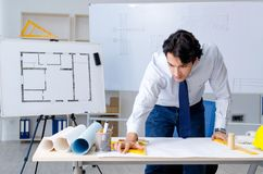 The young handsome architect working on the project. Young handsome architect working on the project stock photography