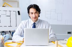 The young handsome architect working on the project. Young handsome architect working on the project royalty free stock photo