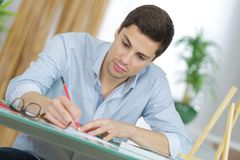 Young handsome artist practise drawing as hobby Royalty Free Stock Photography