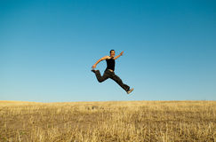 Young handsome asian man jumping Royalty Free Stock Images