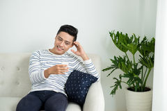 Young handsome asian man using modern mobile smart phone Royalty Free Stock Image