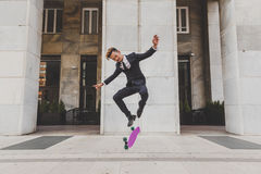 Young handsome Asian model jumping with his skateboard Royalty Free Stock Photo
