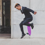 Young handsome Asian model jumping with his skateboard Royalty Free Stock Photography