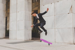 Young handsome Asian model jumping with his skateboard Royalty Free Stock Photos