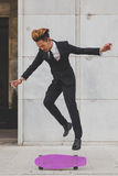 Young handsome Asian model jumping with his skateboard Royalty Free Stock Image