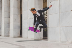 Young handsome Asian model jumping with his skateboard Stock Photos