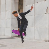 Young handsome Asian model jumping with his skateboard Stock Images