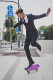 Young handsome Asian model jumping with his skateboard Stock Photography
