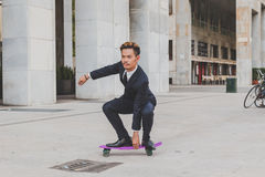 Young handsome Asian model posing with his skateboard Stock Photo