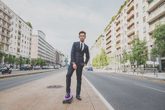 Young handsome Asian model posing with his skateboard Royalty Free Stock Images