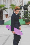 Young handsome Asian model posing with his skateboard Royalty Free Stock Photography