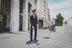 Young handsome Asian model posing with his skateboard Stock Photos