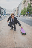 Young handsome Asian model posing with his skateboard Royalty Free Stock Image