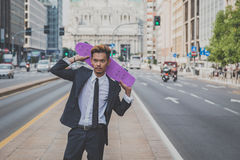 Young handsome Asian model posing with his skateboard Stock Images