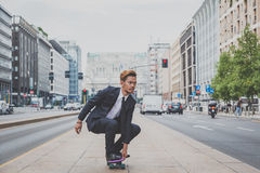Young handsome Asian model riding his skateboard Stock Photography